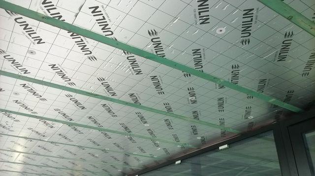 Isolteam isoleren van plafond met PUR-PIR